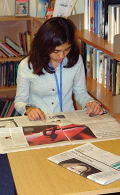 student reading a english newspaper