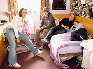 student relaxing in the dorms